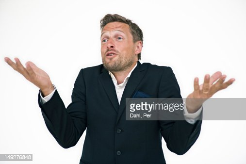 Studio portrait of businessman gesturing