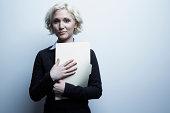 Studio portrait of businesswoman holding file