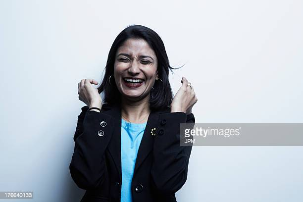Studio portrait of businesswoman laughing