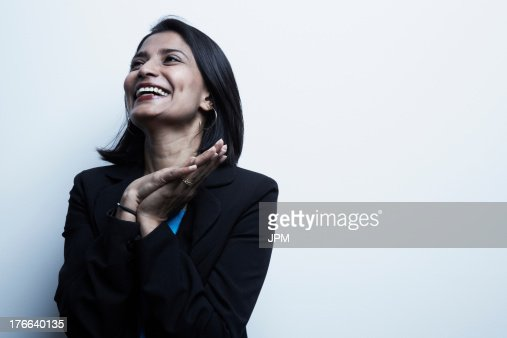 Studio portrait of businesswoman smiling