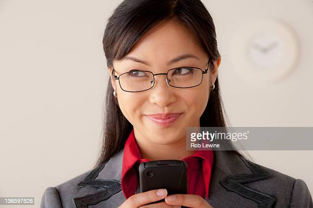 Studio portrait of businesswoman text-messaging