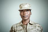Studio portrait of confident female soldier