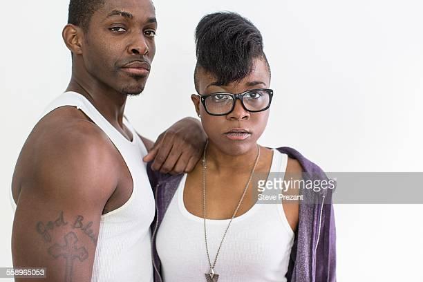 Studio portrait of cool confident couple
