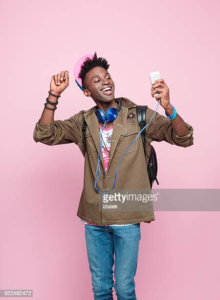Studio portrait of cool, excited afro american young man