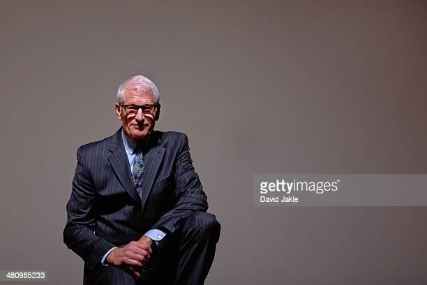 Studio portrait of cool senior man in suit
