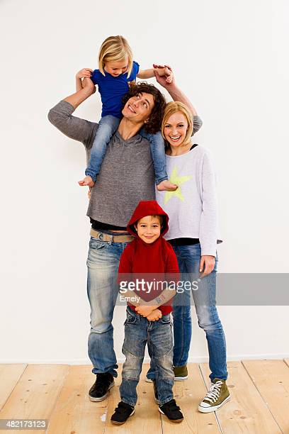 Studio portrait of couple together with son and daughter