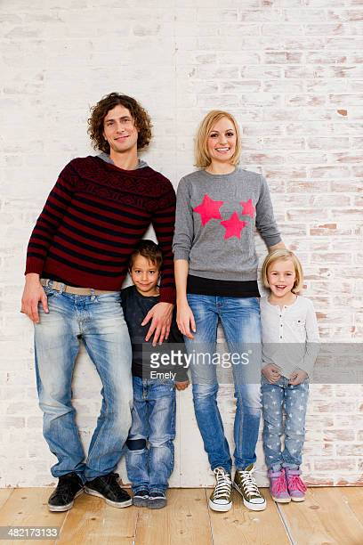 Studio portrait of couple with son and daughter