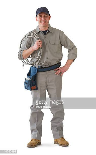 Studio portrait of electrician