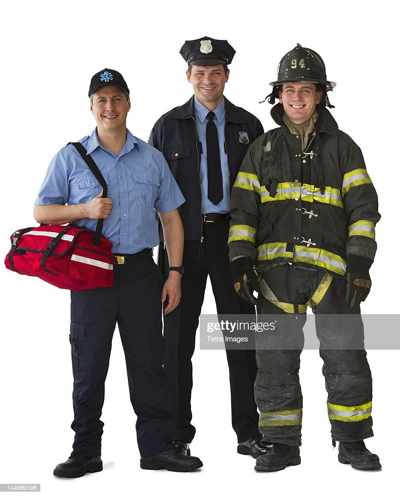 Studio portrait of emergency medical technician, policeman and fireman