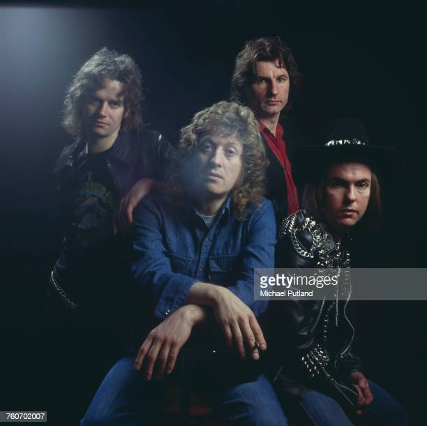 Studio portrait of English rock group Slade posed in London circa 1975 Clockwise from front singer Noddy Holder bassist Jim Lea drummer Don Powell...