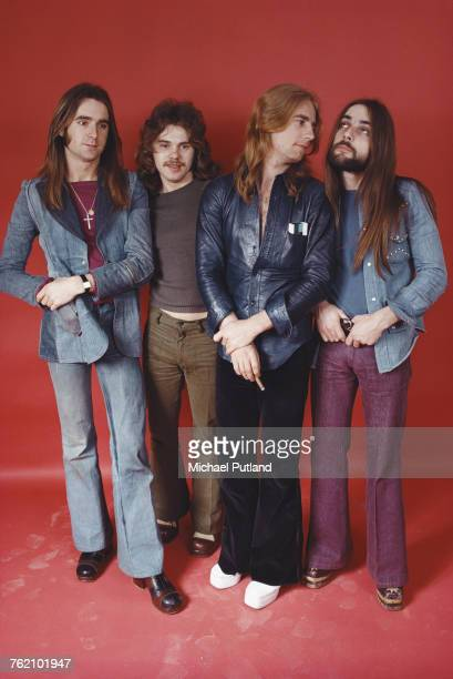 Studio portrait of English rock group Status Quo posed together in London in 1974 The band are from left to right guitarist and singer Francis Rossi...