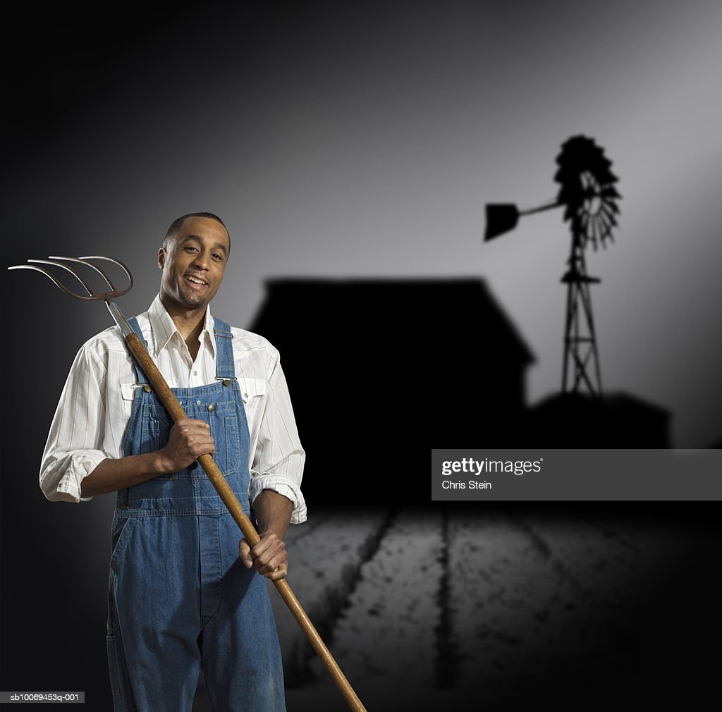 Studio portrait of farmer with shadows behind : Stock Photo