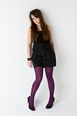 Studio Portrait Of Fashionably Dressed Teenage Girl