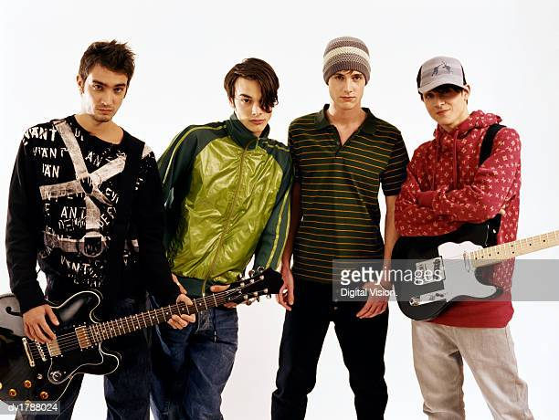 Studio Portrait of Four Teenage Boys With Attitude in a Music Band