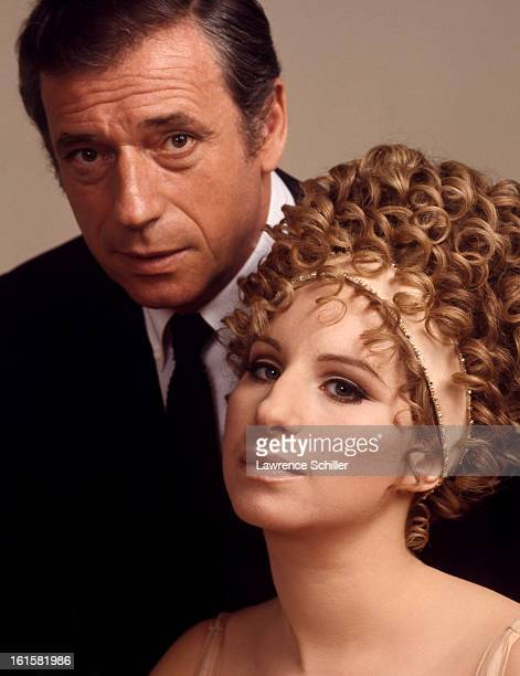Studio portrait of French actor Yves Montand and American singer and actress Barbra Streisand in support of their motion picture 'On a Clear Day You...