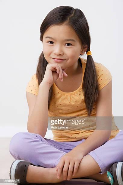 Studio portrait of girl (8-9)