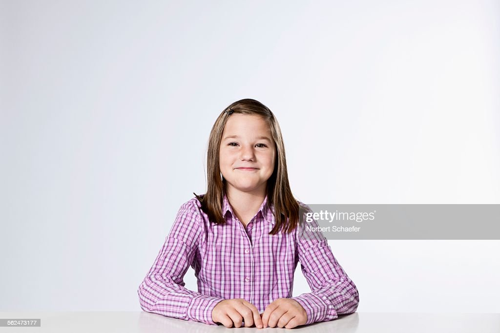 Studio portrait of girl (10-12) smiling