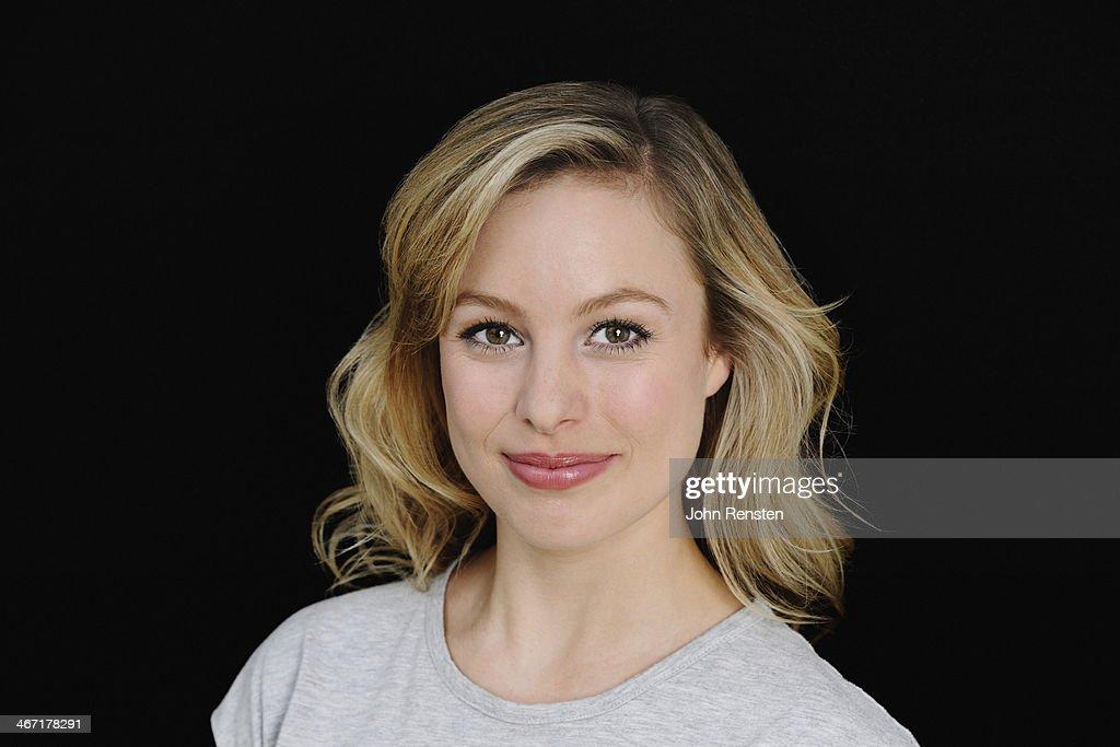 Studio portrait of happy positive woman : Stock Photo