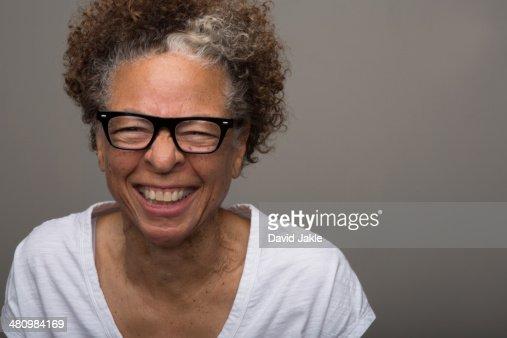 Studio portrait of happy senior woman