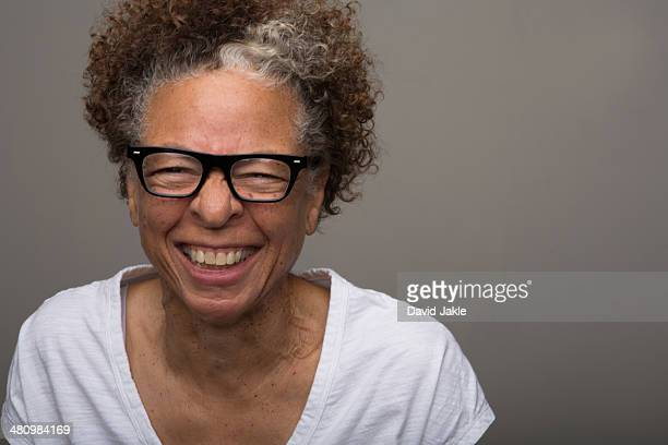 Studio portrait of happy senior woman