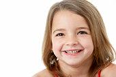 Studio Portrait Of Happy Young Girl
