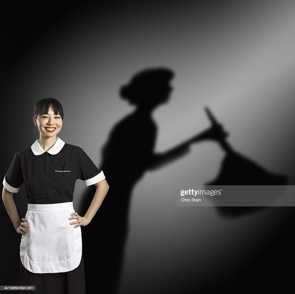 Studio portrait of maid with shadow behind : Stock Photo