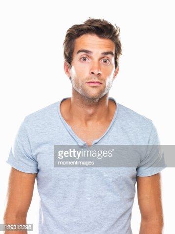 Studio portrait of man with eyes wide open