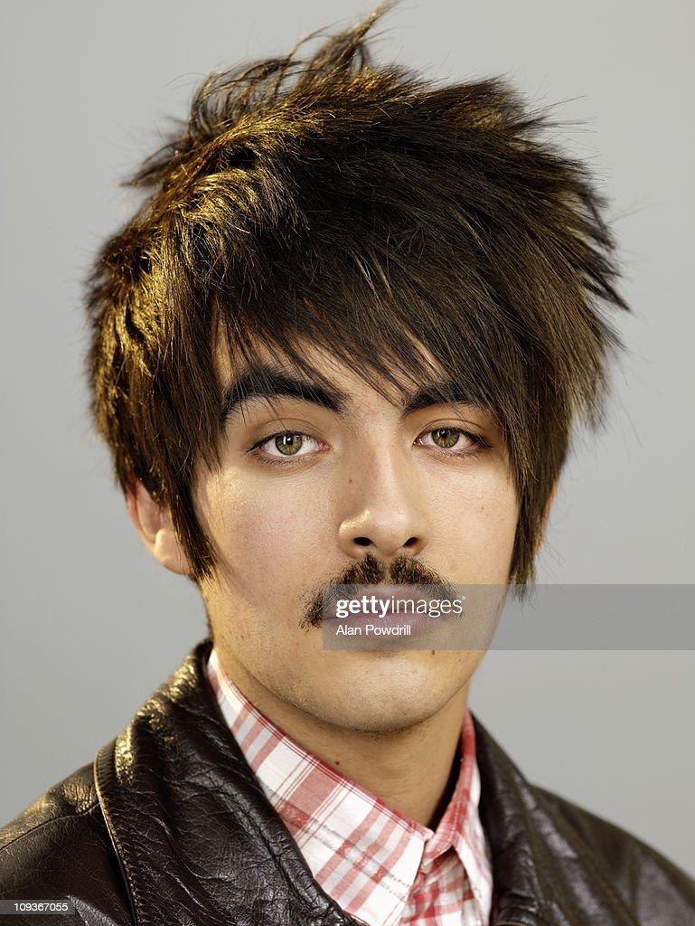 Studio portrait of man with moustache : Stock Photo