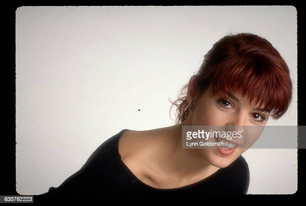 Studio portrait of Marisa Tomei She is shown in a headandshoulders view leaning forward smiling Photograph 1988