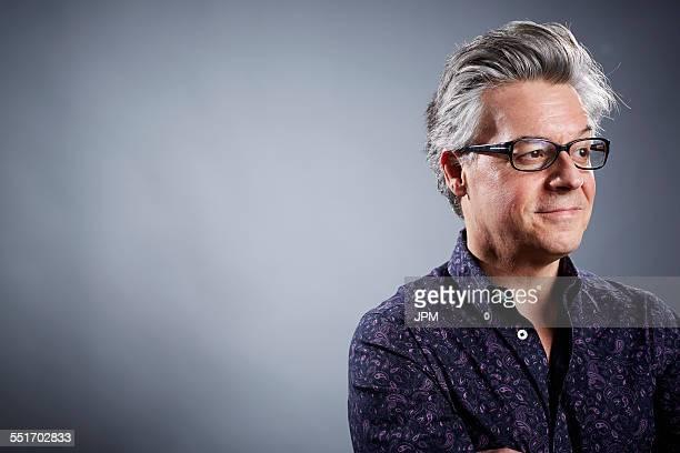 Studio portrait of mature businessman looking away