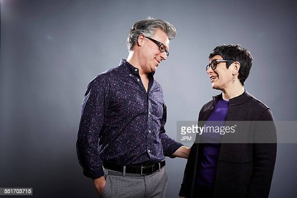 Studio portrait of mature couple face to face