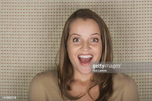 Studio portrait of mature woman laughing
