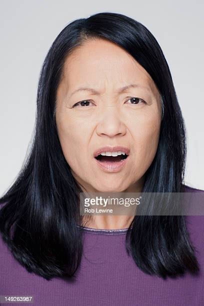 Studio portrait of mature woman with facial expression