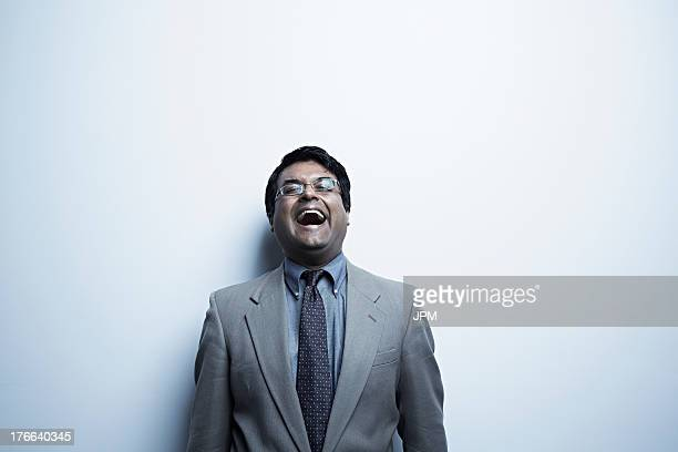 Studio portrait of mid adult male laughing