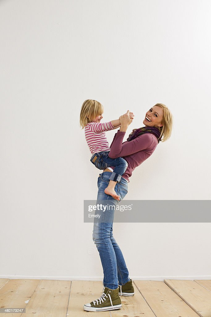 Studio portrait of mother playing with young daughter