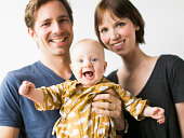Studio portrait of parents with baby son (2-5 months)