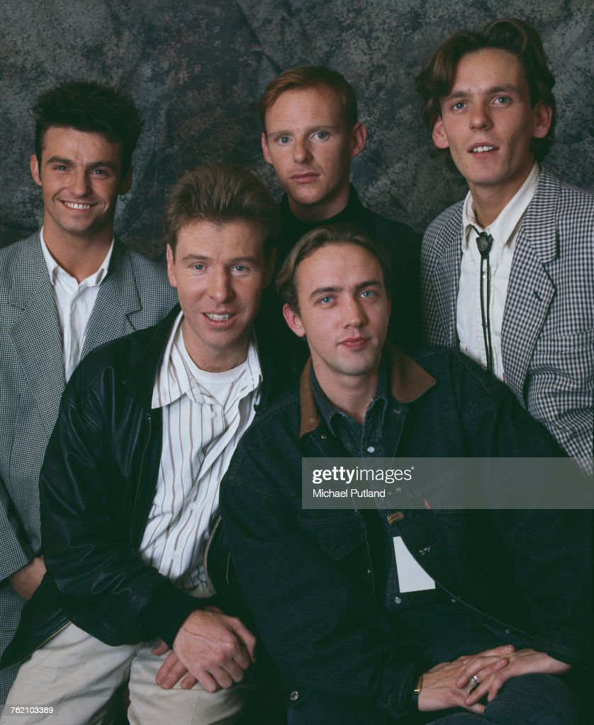 Studio portrait of Scottish pop group Wet Wet Wet posed circa 1988. The band are, clockwise from top left: singer Marti Pellow, drummer Tommy Cunningham, bassist Graeme Clark, keyboard player Neil Mitchell and guitarist Graeme Duffin.