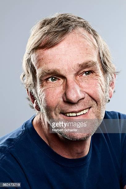 Studio portrait of senior man smiling