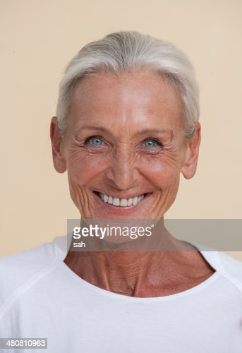 studio portrait of senior woman smiling photo getty images. Black Bedroom Furniture Sets. Home Design Ideas