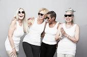 Studio portrait of senior women friends in sunglasses