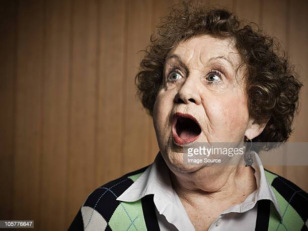 Studio portrait of shocked senior woman