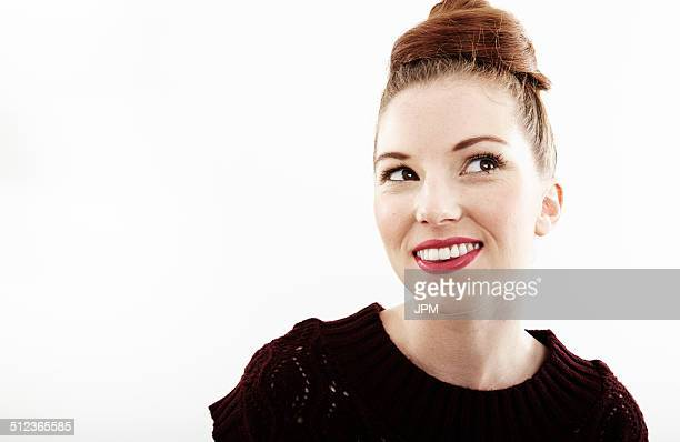 Studio portrait of smiling beautiful young woman