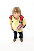 Studio Portrait of Smiling Boy Holding Lunchbox