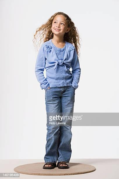 Studio portrait of smiling girl (8-9)