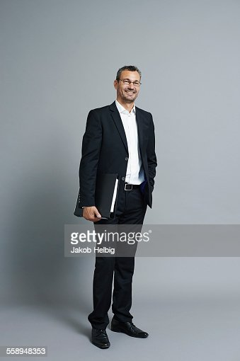 Studio portrait of smiling mature businessman