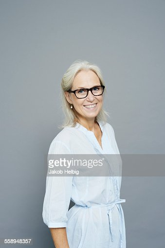 Studio portrait of smiling mature businesswoman