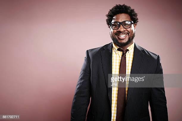 Studio portrait of smiling mid adult businessman