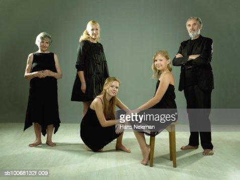 Studio portrait of three generation family including two girls (9-13)