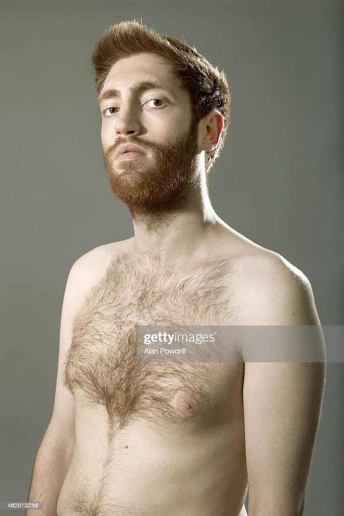 Studio portrait of topless man with beard