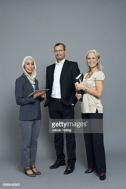 Studio portrait of two businesswomen and businessman
